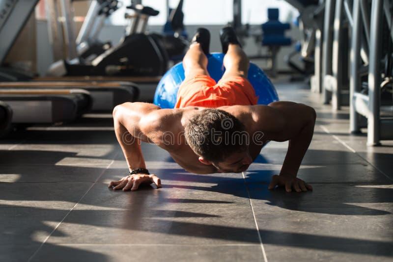 Athlete Exercising Push Ups. Young Model Doing Push Ups As Part Of Bodybuilding Training stock photography