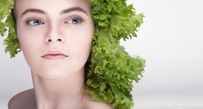 Young model hairstyle salad. A healthy diet, the key to losing weight, versatile diet.Vegetarian royalty free stock photos