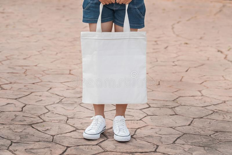 young model holding white tote bag for mockup blank template stock photography