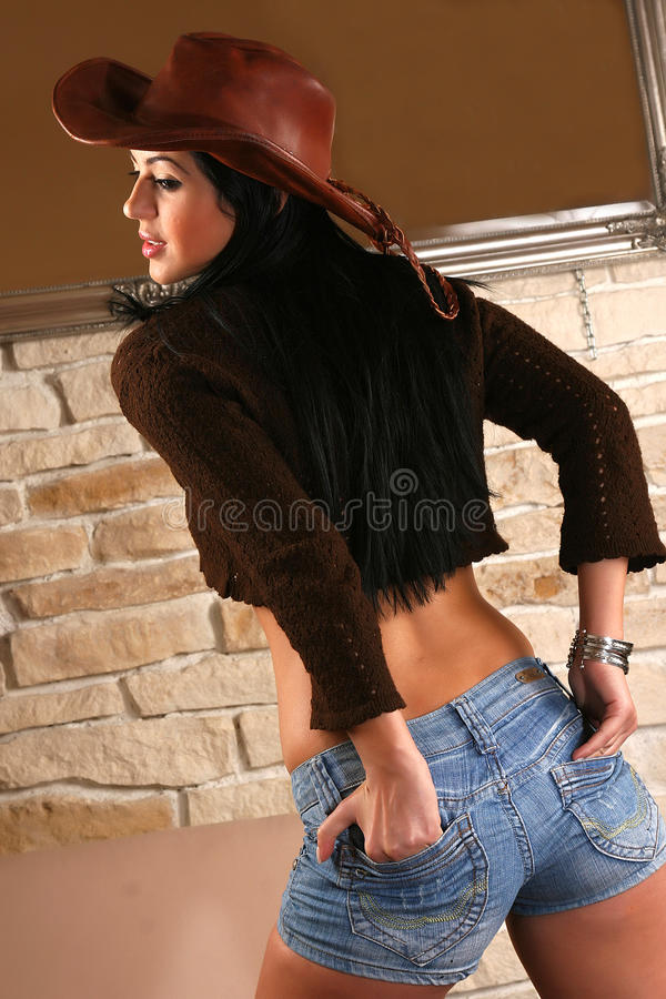 Young model posin. Young model in short jeans stock photography