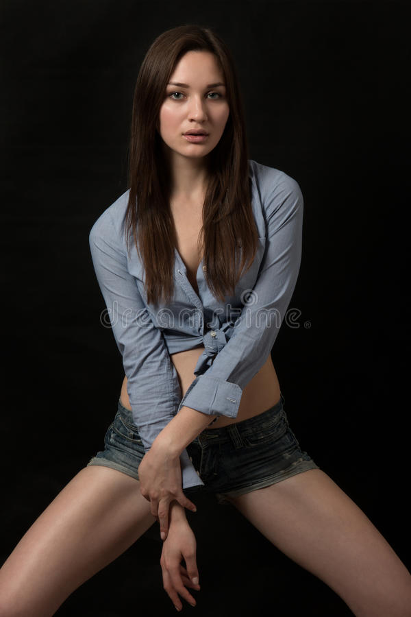 Young model posing over dark background royalty free stock image
