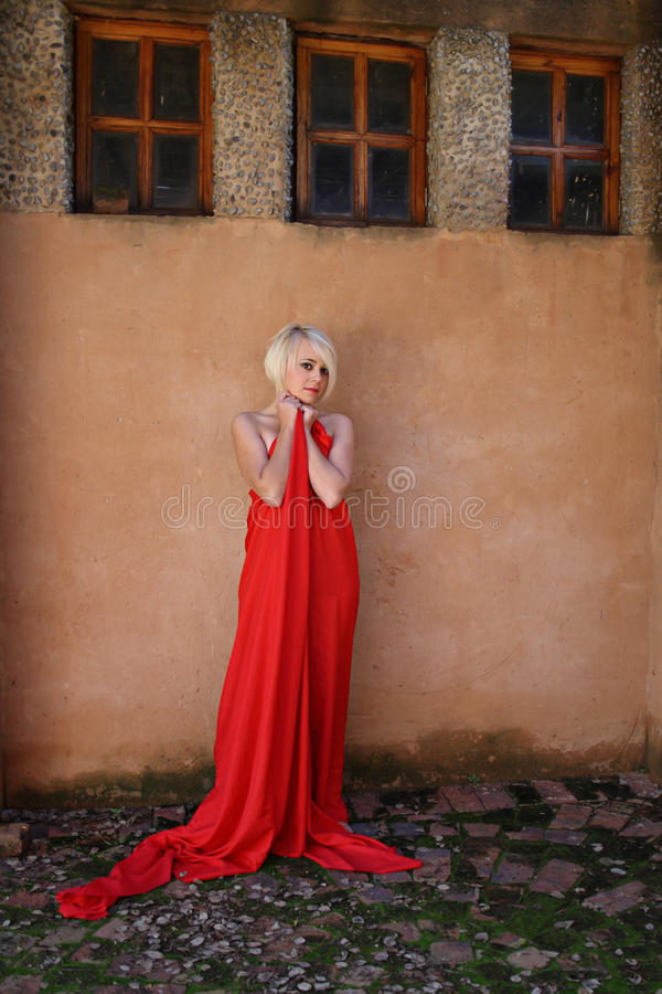 Young model posing with red satin stock images