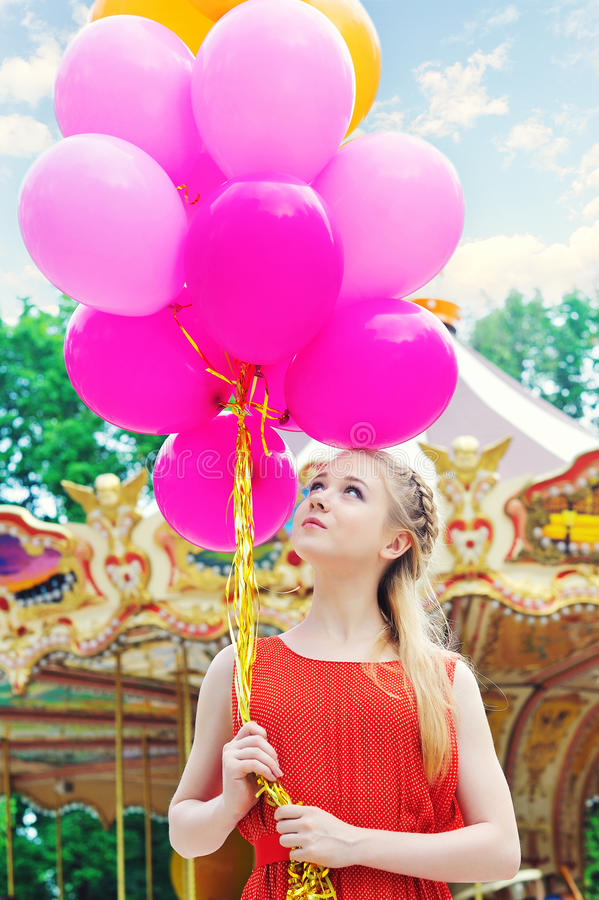 Young model woman with bright balloons royalty free stock images