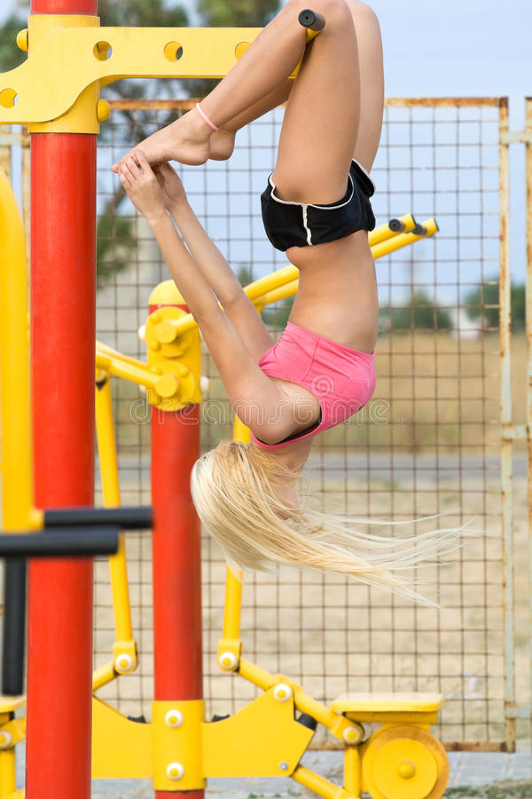 Young model working out on fitness playground stock photography