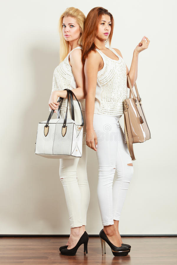 Young Models With Handbags. Stock Image