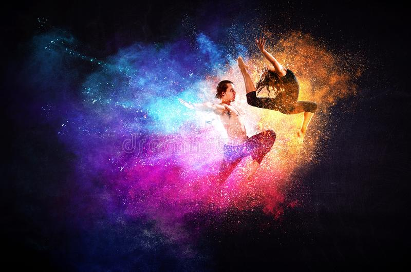 Young modern ballet dancers in a jump. Mixed media stock photography