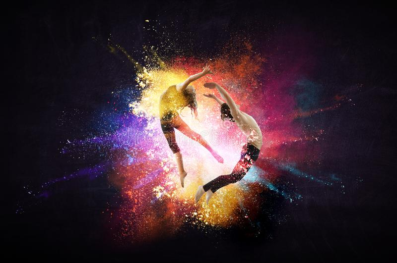 Young modern ballet dancers in a jump. Mixed media stock images
