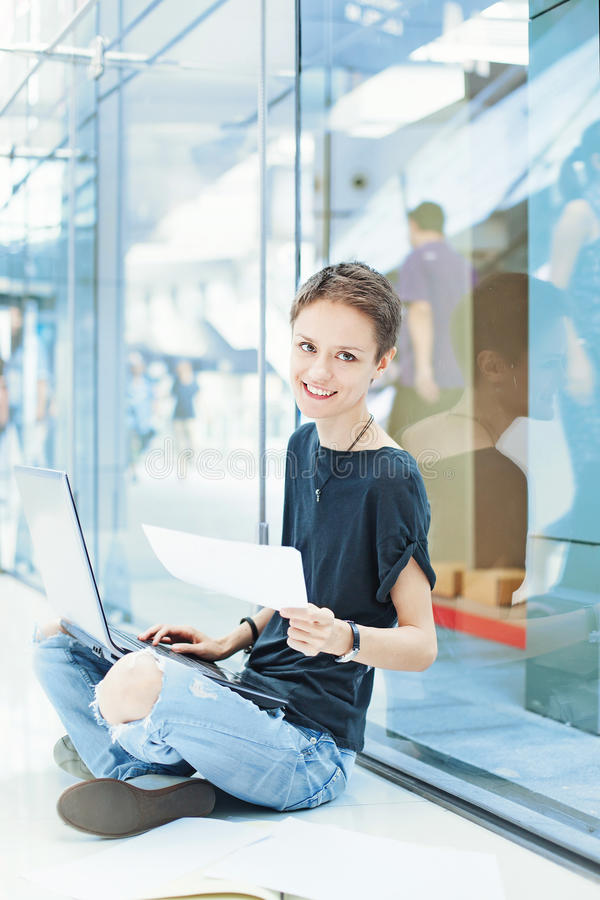 Young modern female worker inventing new ideas royalty free stock photography