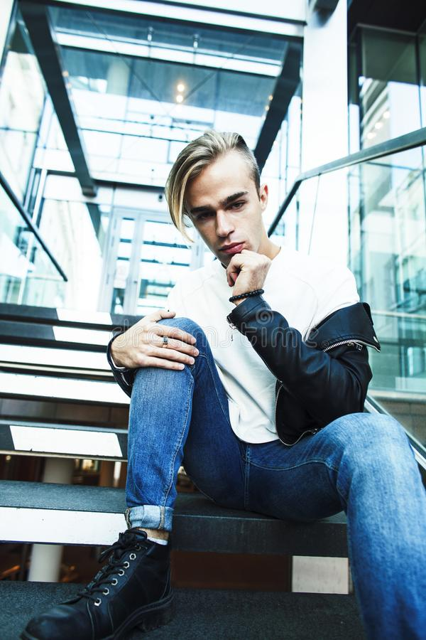 young modern hipster guy at new building university blond fashio royalty free stock photography