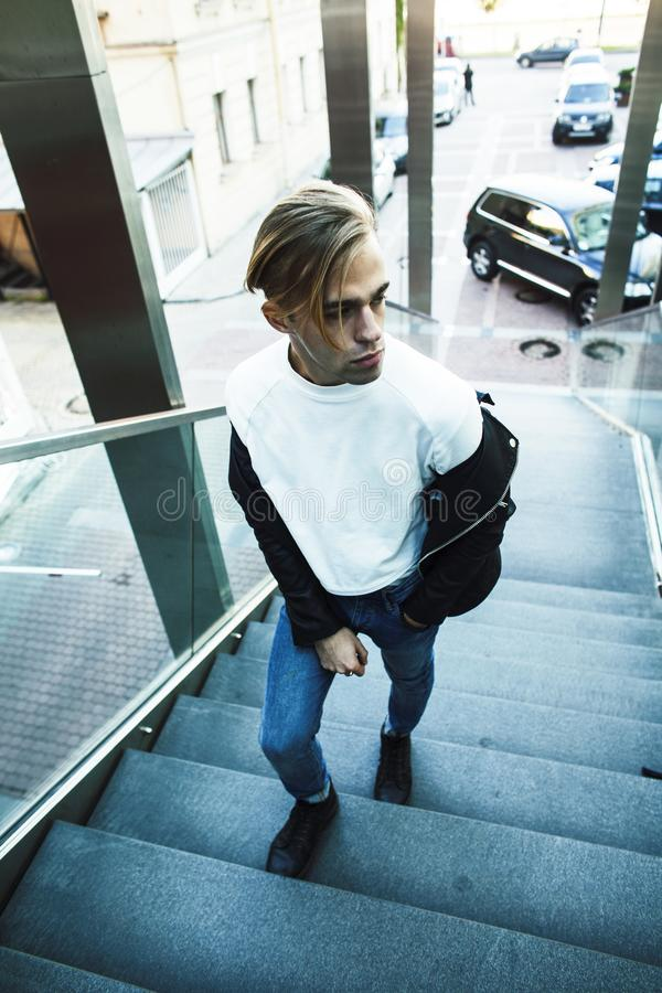 young modern hipster guy at new building university blond fashio royalty free stock image