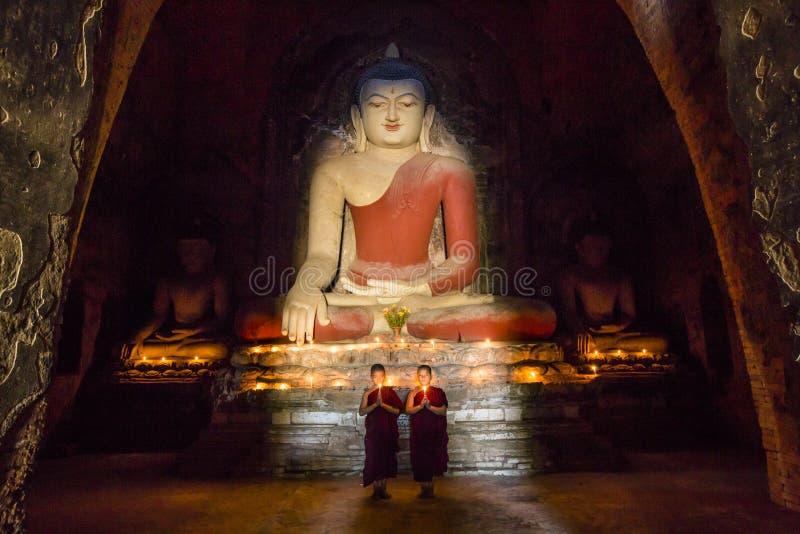 Young monk and big Buddha royalty free stock image