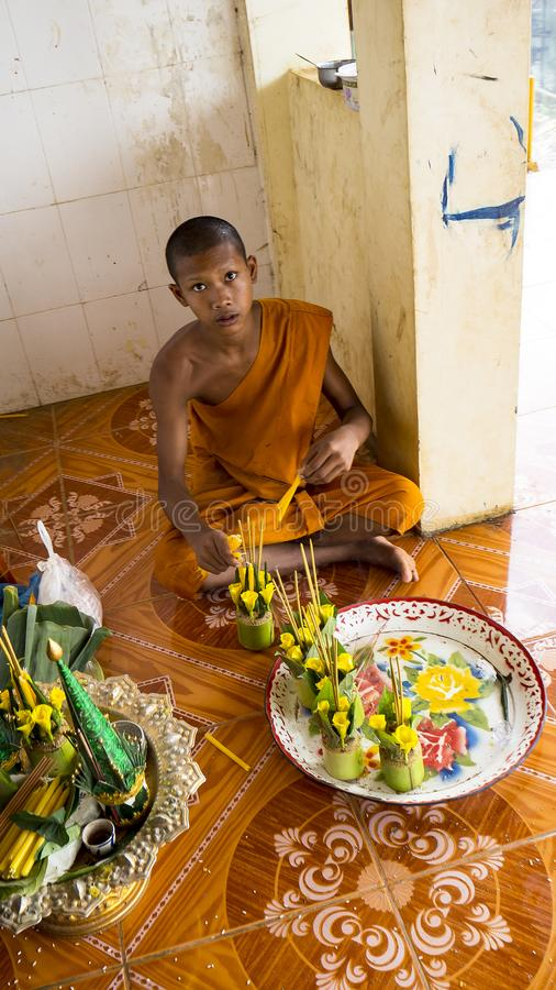 Young monk in a buddhist temple. TONLE SAP, SIEM REAP, CAMBODIA - NOVEMBER 13, 2017: Young monk is walking in buddhist temple stock photo