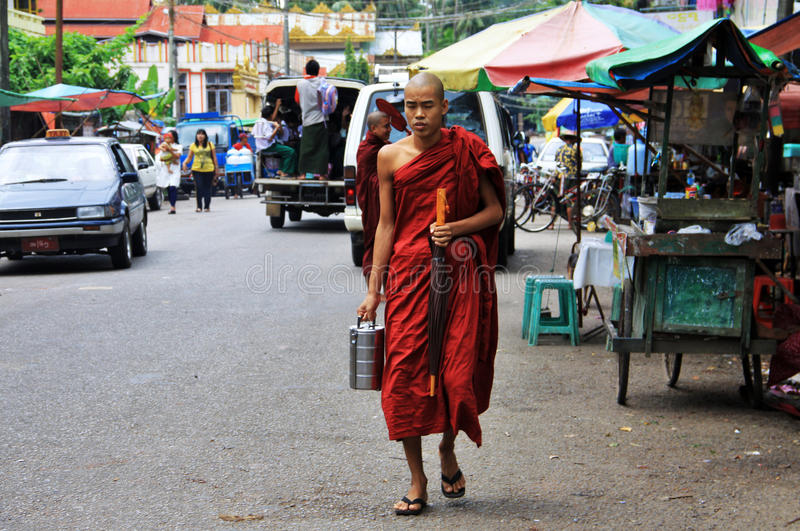 Download Young Monk Walking In Yangon With Offering Lunch Editorial Photo - Image: 25479616