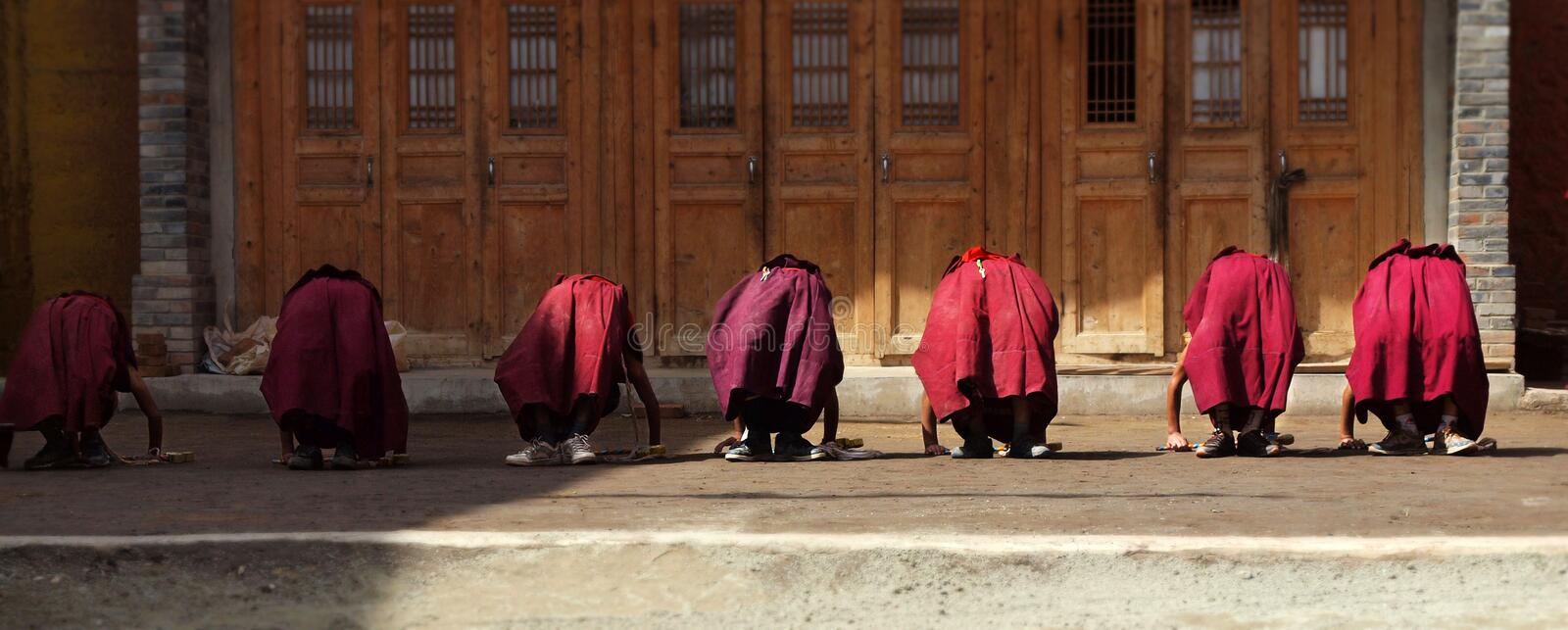 Young monks doing exercice. At labrang monastery,Xiahe,china royalty free stock images