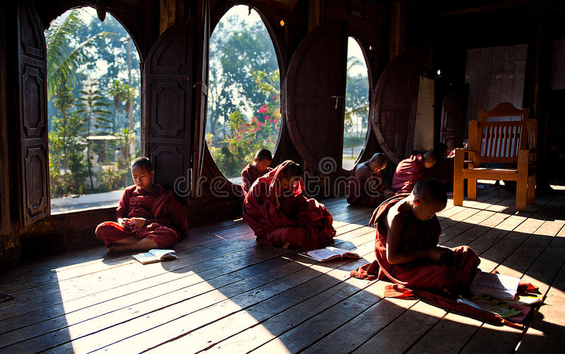 Young monks learning in monastery Myanmar. Near Nyaungshwe Inle Lake stock photos