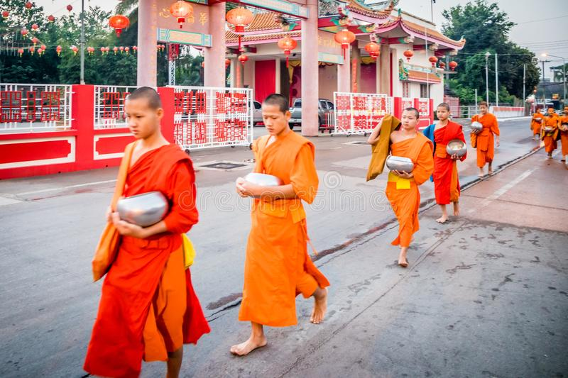 Young monks walking royalty free stock photo