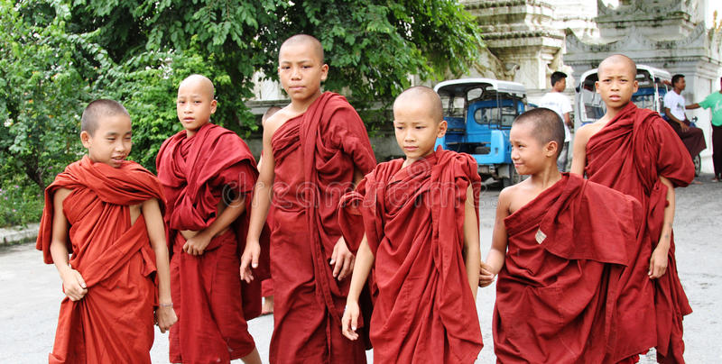 Young monks walking at the village in Shan, Myanmar.  royalty free stock image