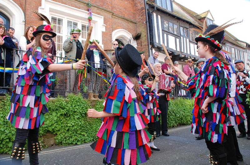Young morris dancers, Hastings. Young Morris dancers perform in the Old Town during the parade at the annual Jack In The Green festival at Hastings in East stock photos