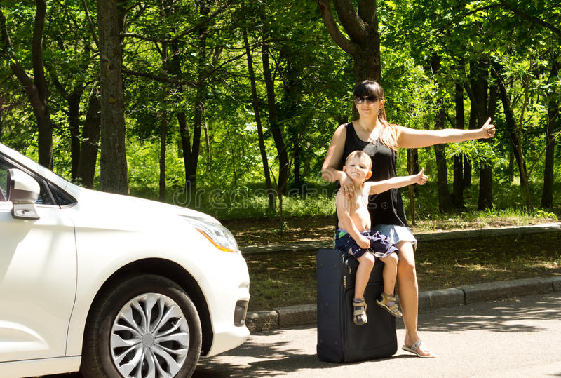 Download Young Mother Asking For A Lift By The Roadside Stock Photo - Image: 31333856