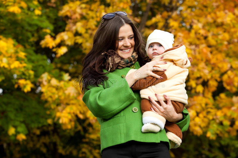 Download Young Mother With Baby In Arms Up Stock Image - Image of outdoor, outside: 21625381