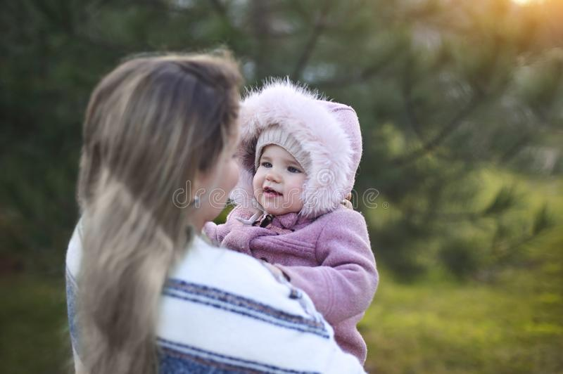 Young mother and baby daughter outside together. Autumn portrait royalty free stock image