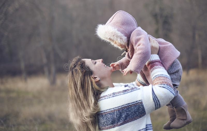Young mother and baby daughter outside together. Autumn portrait stock photo