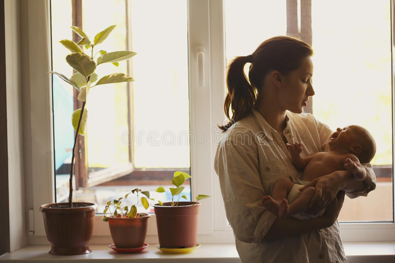 Young mother with baby at home stock images