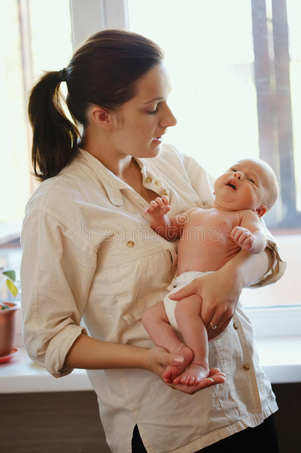 Young mother with baby at home royalty free stock photo