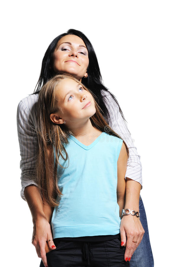Young mother with daughter. Mother with daughter on white background. Happy family royalty free stock images
