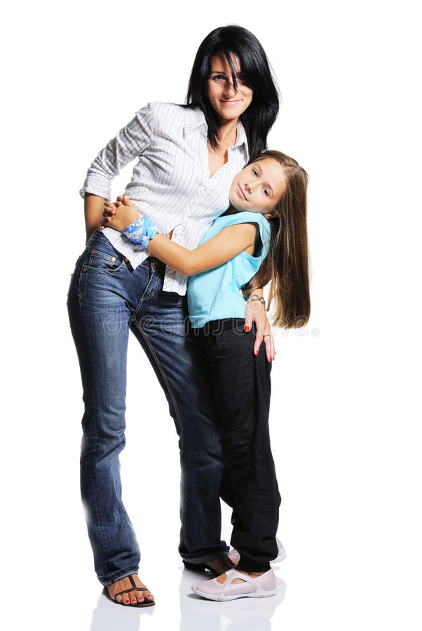 Young mother with daughter. Mother with daughter on white background. Happy family stock photos