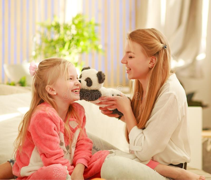 Young mother and daughter are having fun playing at home, happy parenting and family leisure stock image
