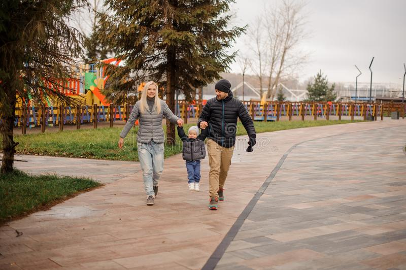Young mother and father walking with a little son royalty free stock photography