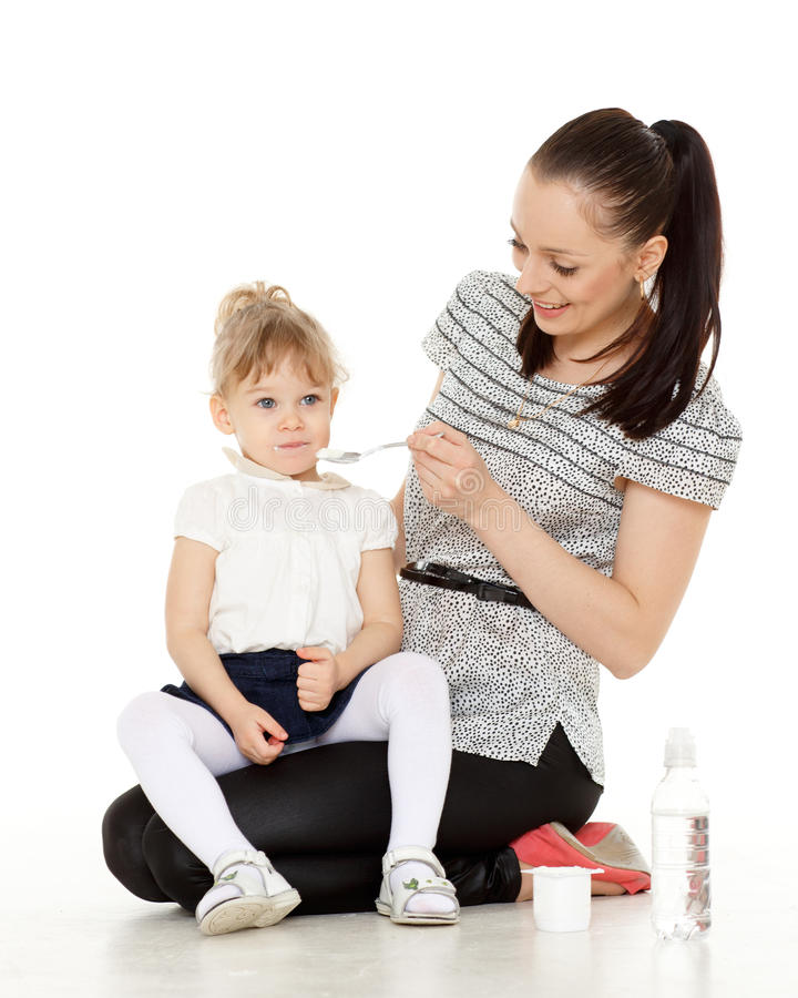 Download Young Mother Feeds  Her Baby. Stock Photo - Image: 38504396