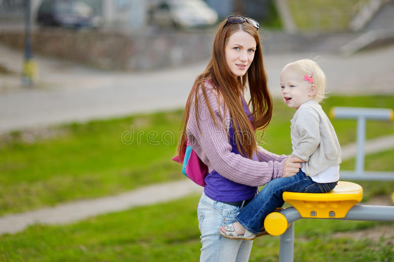 Young mother and her adorable daughter royalty free stock images