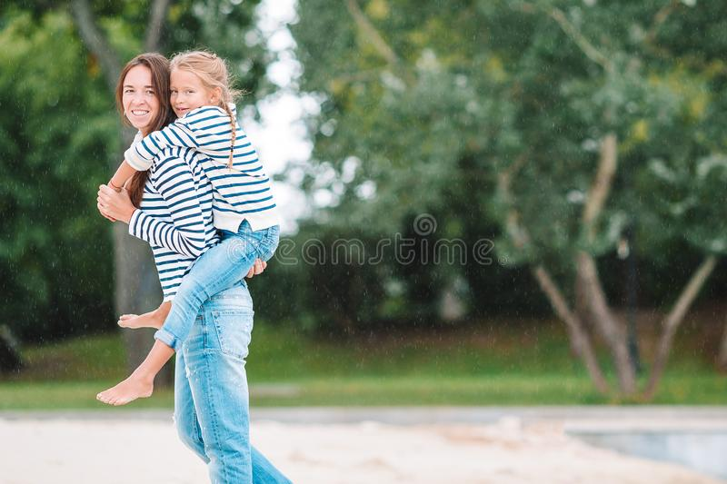 Happy mom and adorable little girl enjoying summer vacation. Young mother and her adorable little girl enjoying vacation near the lake royalty free stock images