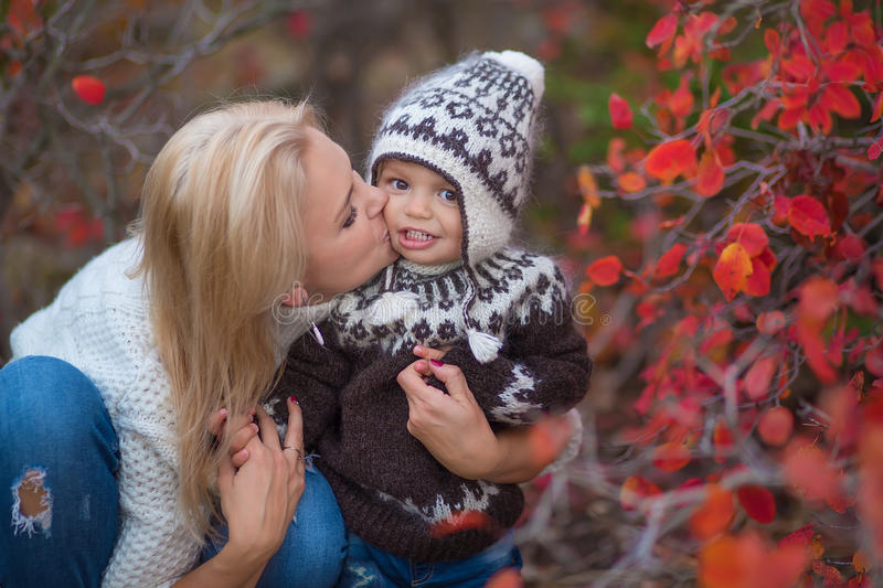 A young mother and her baby fall fun stock image