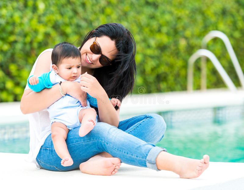 Young Mother With Her Baby Near The Swimming Pool Stock Image Image 57401933