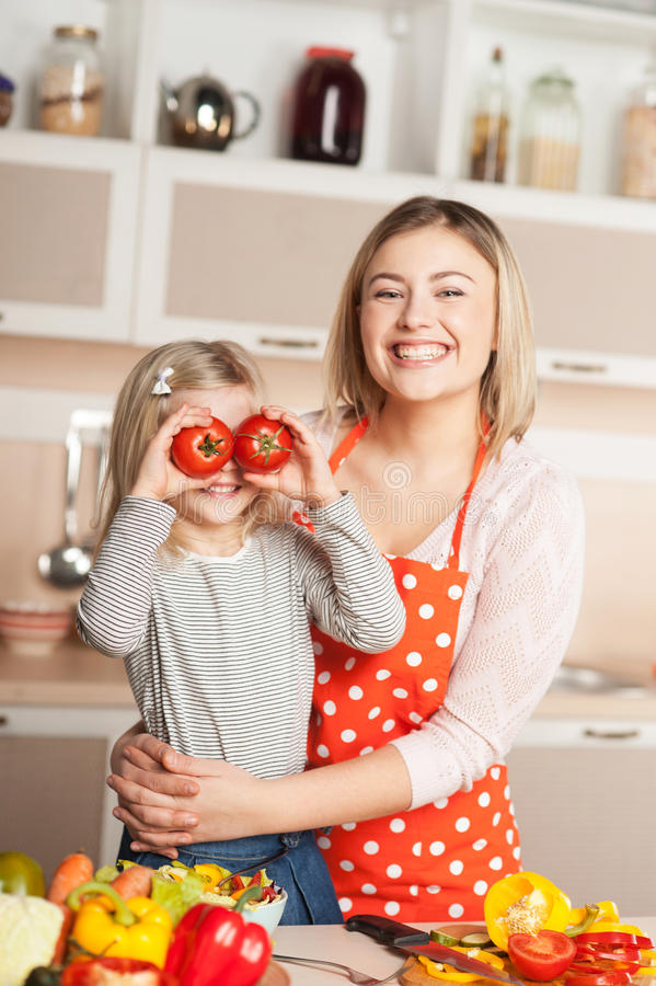 Young mother and her daughter having fun while royalty free stock photo