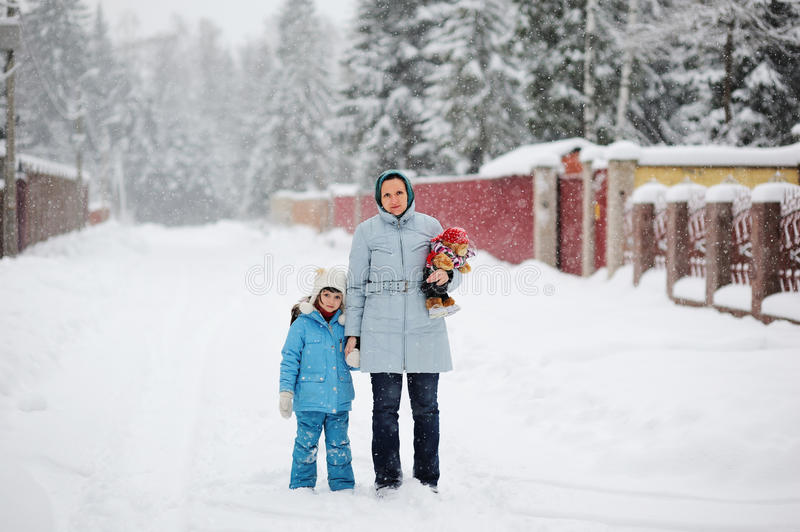 Download Young Mother And Her Daughter In A Snowfall Stock Photography - Image: 22918052
