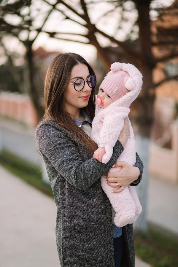 Young mother with her little baby. Mom hold baby on hands. Happy family royalty free stock image