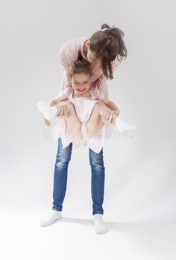 Young Mother and Her Little Cute Daughter Playing Together. royalty free stock photos