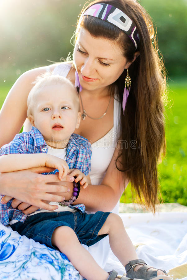 Young Mother with her son, Child has Cerebral palsy. Young Mother with her son in a park, Child has Cerebral palsy stock photography