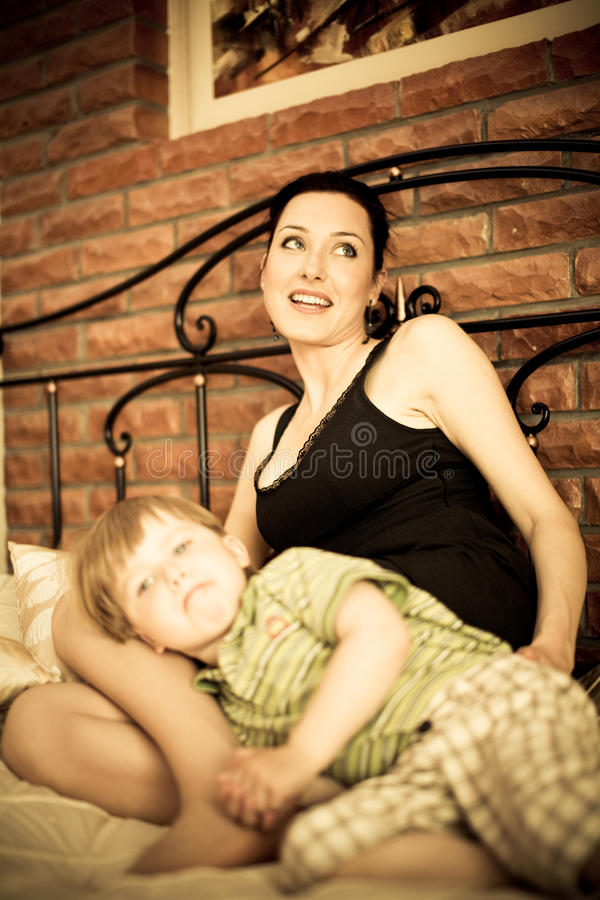 Download Young Mother With Her Son Relaxing On The Bed Stock Photo - Image: 11061744