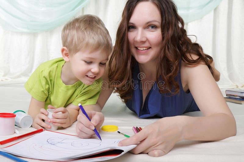 Young mother and her son spend time together stock photo