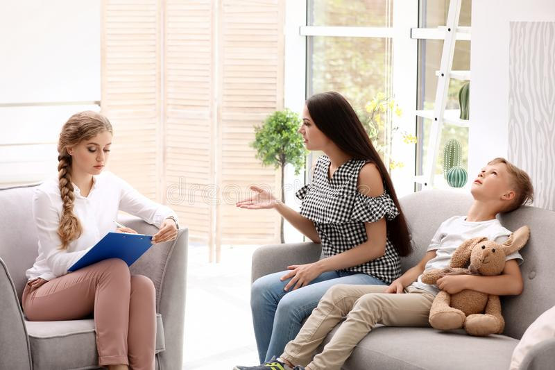 Young mother and her son visiting child psychologist royalty free stock images