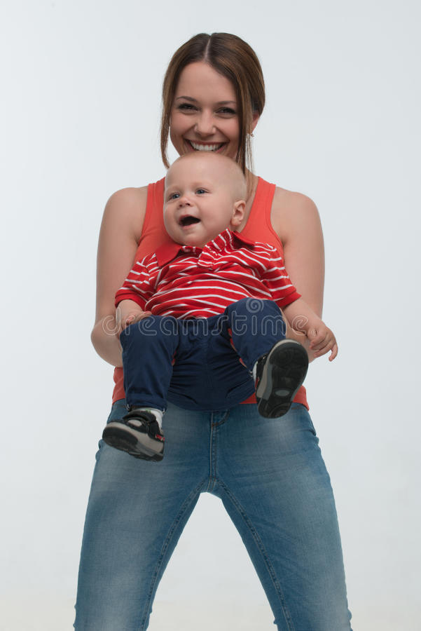 Young mother and her toddler son having fun stock photography