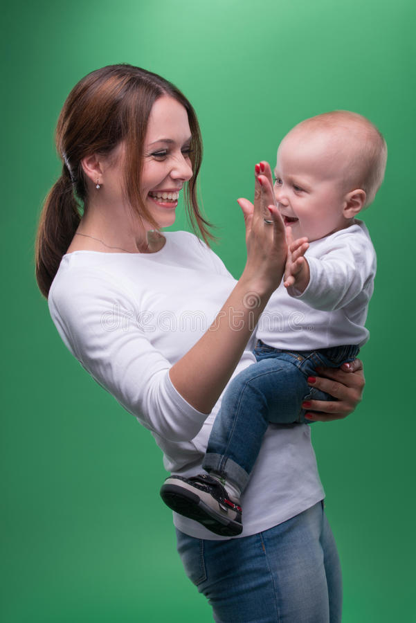 Young mother and her toddler son pointing at stock photo