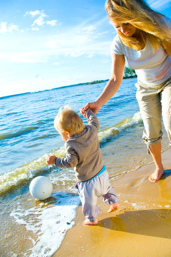 Young Mother And Her Toddler Walking Royalty Free Stock Photos