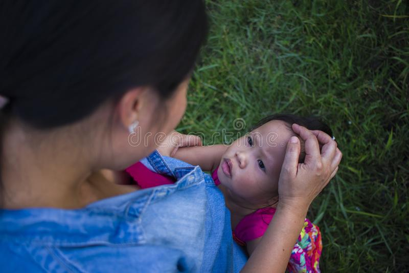 Young mother hugging and soothing a crying little daughter, Asian mother trying to comfort and calm down her crying child royalty free stock photo