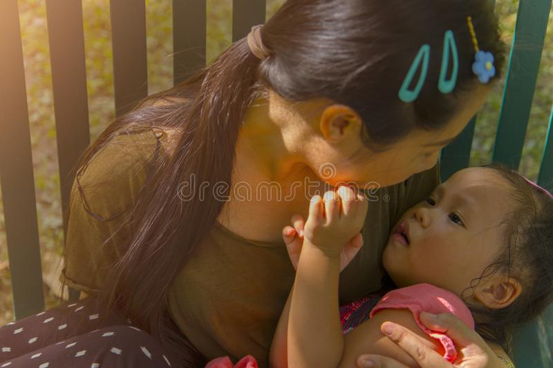 Young mother hugging and soothing a crying little daughter, Asian mother trying to comfort and calm down her crying child. High resolution image gallery royalty free stock photos